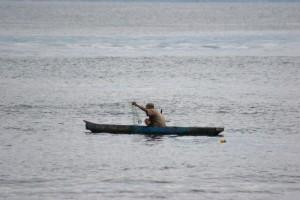 fisherman working his nets
