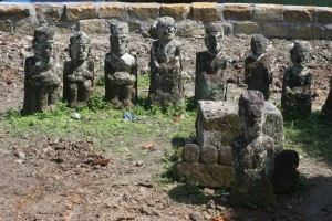 a circle of stone sculptures in the royal cemetary of Tomok