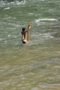 boy fishing in the river