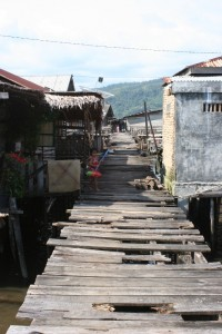 walkway in between houses on stilts