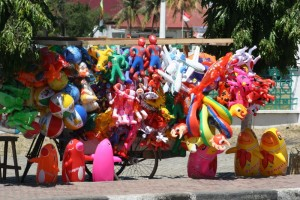 outside the mosque, plastic toys being sold