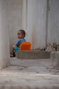 and a young boy in the backstreets of Khiva
