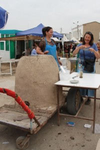 the mobile clay oven, and a cook selling samsas to a brave tourist