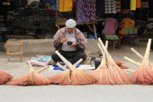 broom seller having his lunch