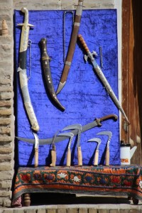 tools for ancient trades: swords for fighting, hook knives for carpet weaving