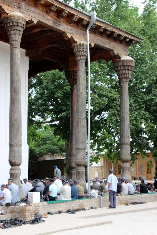 men praying in the Dorus Sidiat mosque, still an active mosque
