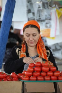 to add a bit of colour, tomato sales woman