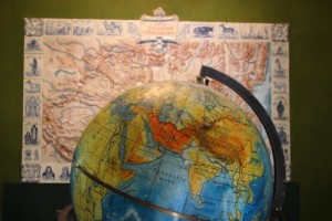 the globe, centred on Central Asia, and the 3D map with the Przhevalsky expeditions