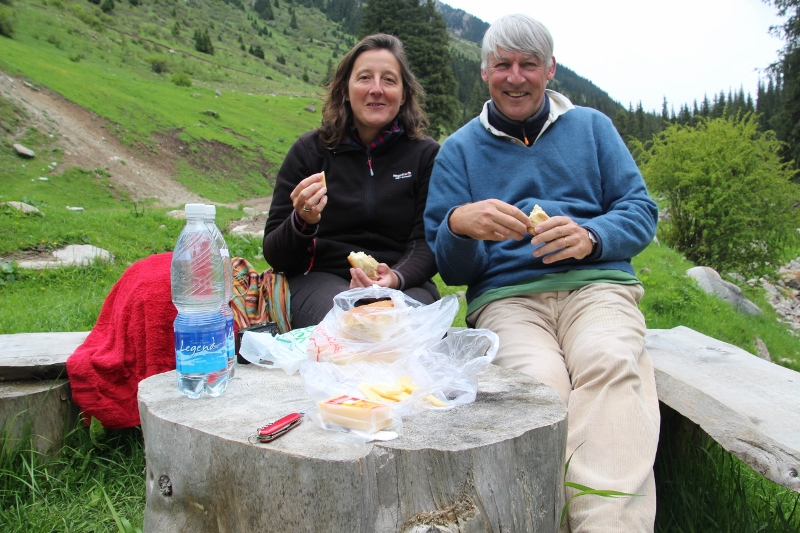 same tourists, now fully dressed enjoying lunch along the road