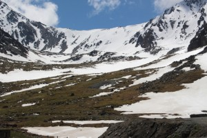 the mountains surrounding the tunnel; somewhere there is the pass