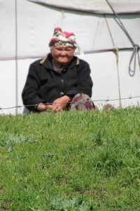 older lady in front of her yurt