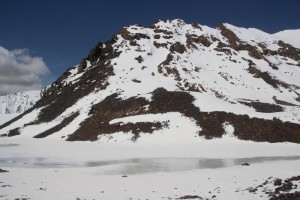 at the pass, a frozen-over lake