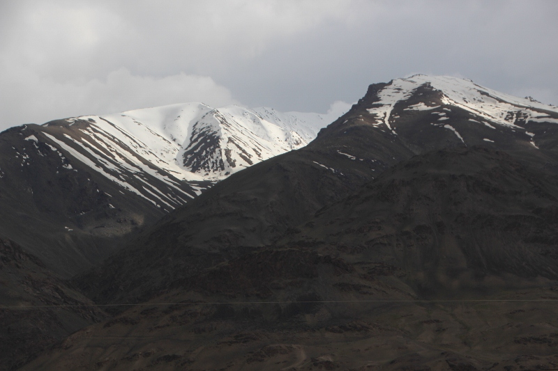 Afghan snow-covered mountains all along the border