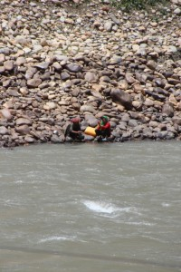 two Afghan women on the far side of the Panj River