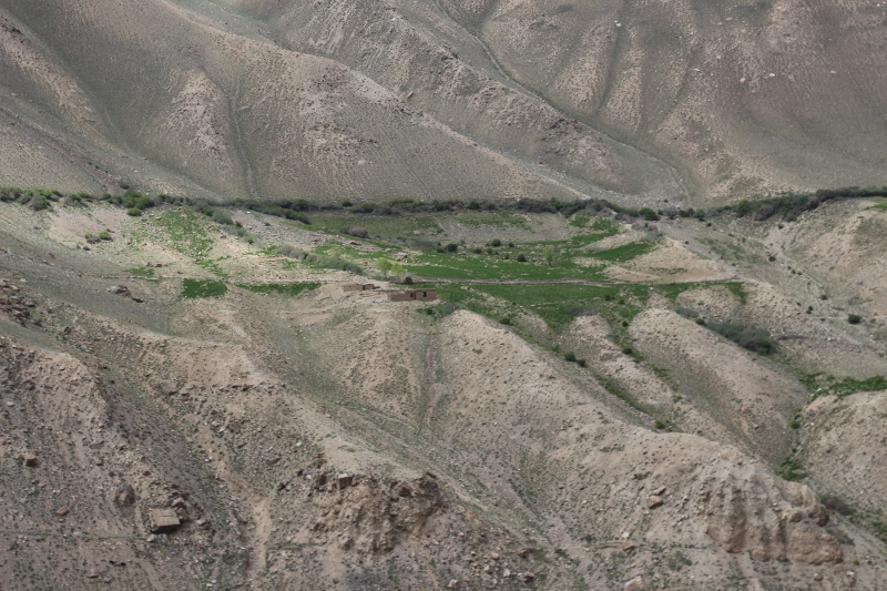 patches of green around the houses, on the dry slopes