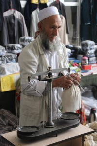 a real medicine man, weighing herbs of a special cure