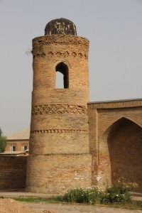 at least one of the towers, or minarets, of the nearby madrasse is still original