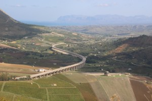 a motor way snaking through the Sicilian landscape