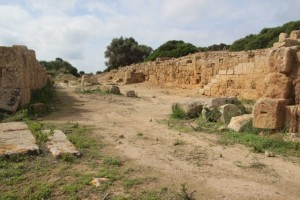 a wide street, the entrance to the Phoenician city of Monzi