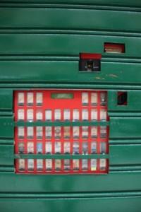 cigarette vending machine, most of it hidden behind a door