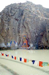 a Buddha image across a lake, at entrance of Lhasa