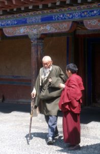 a monk helps an old man, Sera monastery