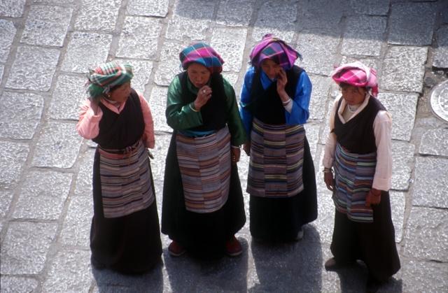 four Tibetan women contemplating