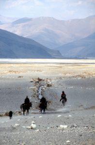 Tibetans on horseback, on the Tibetan plateau towards Nepal