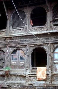 the wooden windows in a courtyard