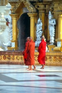 and three male pilgrims, or monks