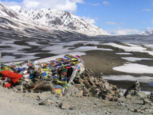 prayer flags along the road, crossing a high plateau (courtesy Gijs Remmelts)