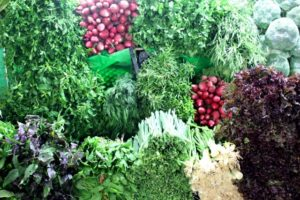 enormous bunches of fresh herbs, spring onins and radice, part of the Iranian meal