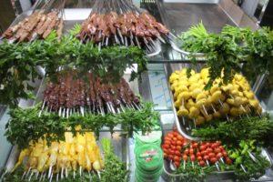 an enterprising kebab shop, with mushroom, tomato and liver kebabs