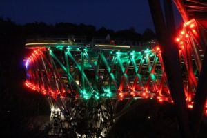 the bridge by night, lit in different and varying colours
