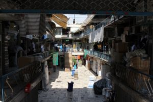 one of the little open squares in the bazaar, with three levels of shops