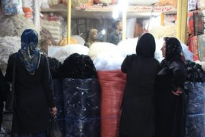 and women shopping for wool