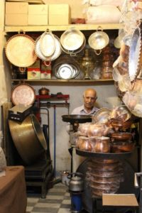 and the copper seller, proudly in between his wares