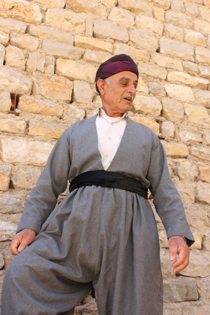 a Kurdish man in his Friday best