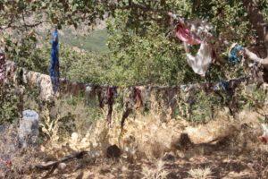 the pieces of cloths near the shrine