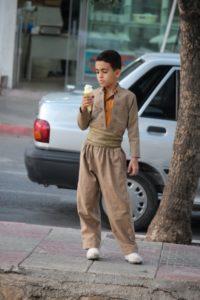 proud boy, in typical Kurdish suit