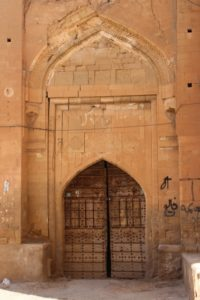 an old door, in an attractive, yet simple arch