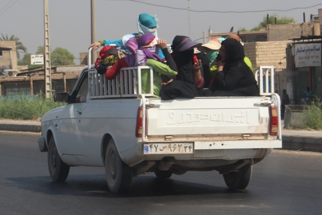 unusual in Iran, it is the women, this time, who provide the colour...