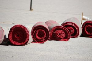 carpets in the same mosque, ready to be rolled out