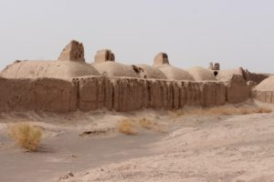 houses from the ancient settlement, with early badgir towers, to catch the wind and cool the house