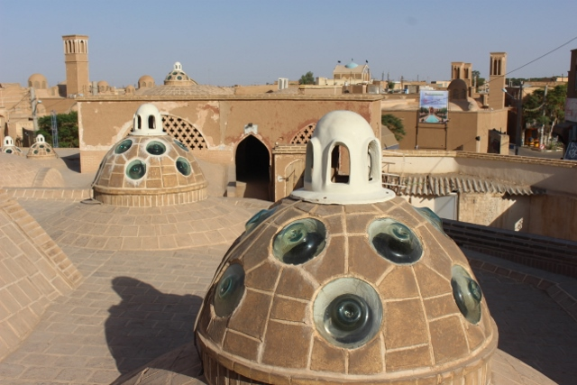 on the roof of the Hamman-e Sultan Mir Ahmad, each cupola provides light downstairs in one of the many rooms