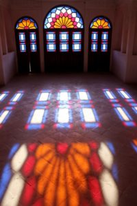 colours of stained glass projected on the floor of the Khan-e Tabatabei, one of the historical houses in Kashan