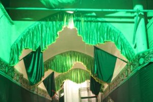 a covered alley has been decorated, green being the colour of Islam