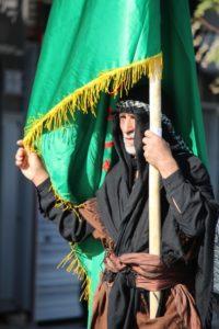 a man leading the procession in Bijar