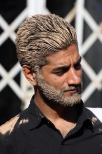 some have applied the mud more stylish, in hair and beard