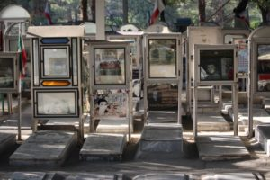 glass boxes with war memento adorn the martyrs graves